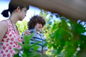 """Cameron Christensen listens to the dulcet vibrations produced by a bug on a plant during the Summers @ Mizzou camp """"The Arts as a portal to Science Communication."""" // photo by CALEB O'BRIEN/BondLSC"""