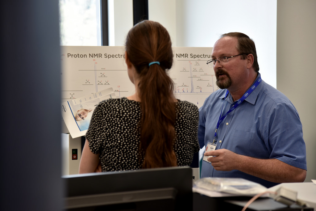 Lloyd Sumner, director of the MU Metabolomics Center, and Assistant Professor Ruthie Angelovici discuss the use of NMR for metabolite identification during the University of Missouri Metabolomics Center open house on Aug. 12. | photo by Zivile Raskauskaite, Bond LSC
