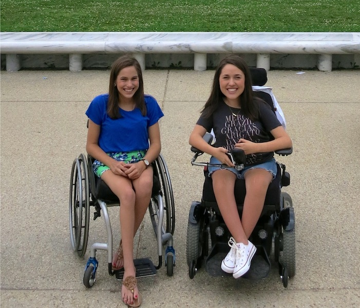 Lauren,17 (left) and Claire, 16 (right), say their shared SMA diagnosis has strengthened their relationship and presented them with opportunities to travel and share their experiences. | Photo provided by the Gibbs family.