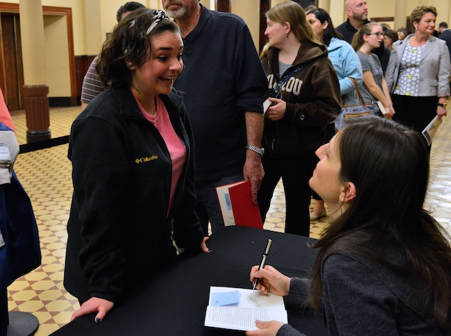 Rebecca Skloot signs copies of her book, The Immortal Life of Henrietta Lacks, after the talk Monday at Jesse Hall