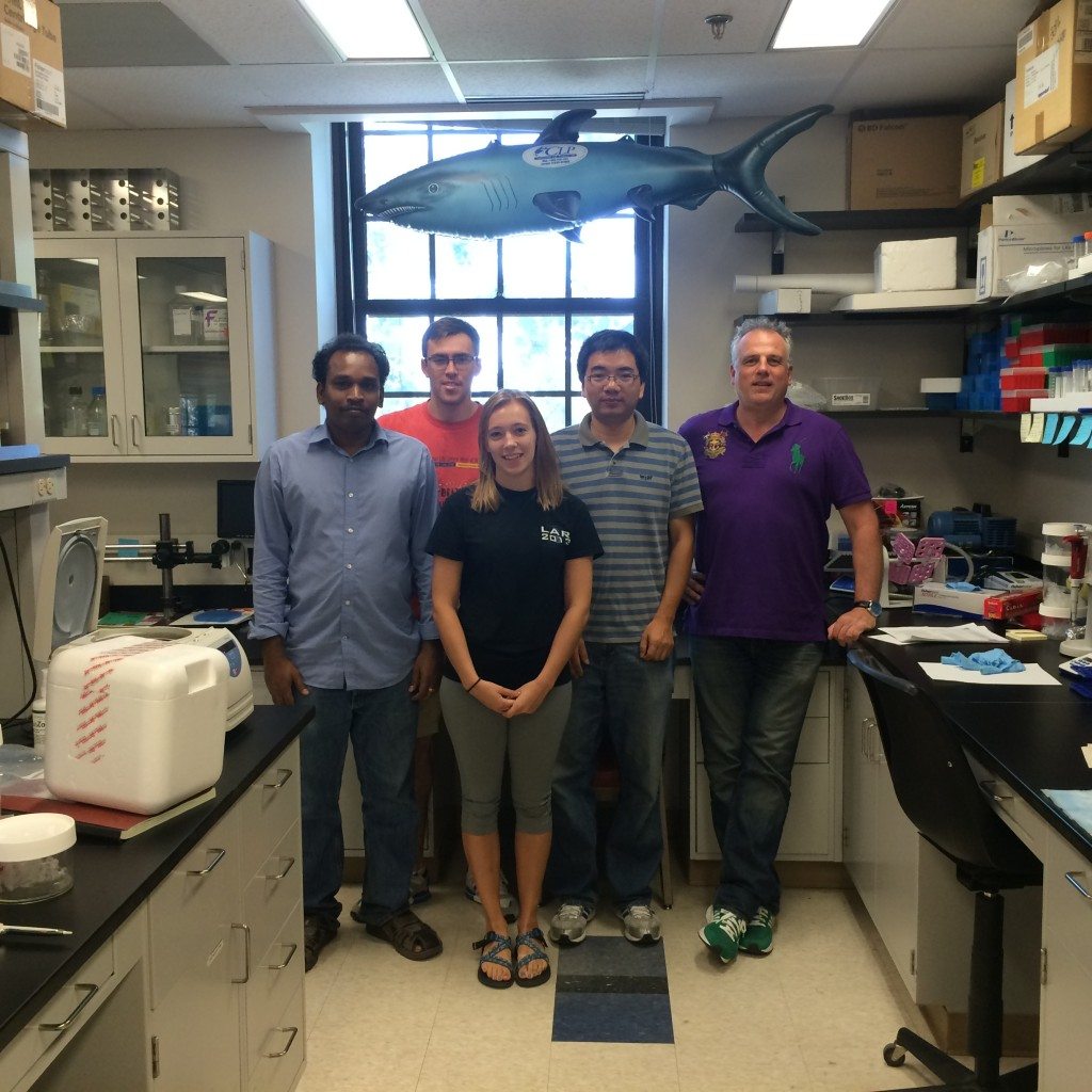 Alexander Franz (far right), an assistant professor of veterinary pathobiology at MU who demonstrated that CRISPR is effective in mosquitoes, stands with his lab. From left to right: Velmurugan Balaraman, Asher Kantor, Hannah Gerlt, and Shengzhang Dong. //Photo by Alexander Franz