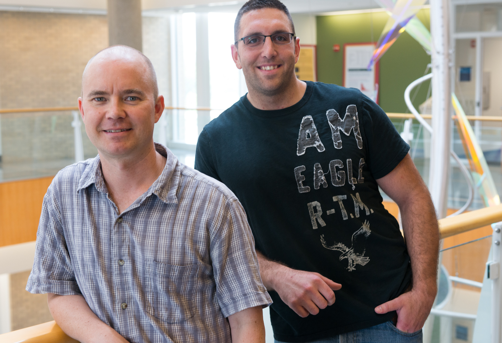Marc Johnson (left) with a post doctoral student that works in his lab. The lab does important research on the basic function and mechanisms of viral navigation and transport.